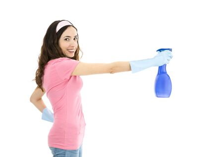 spraying: Spring cleaning woman spraying with a detergent