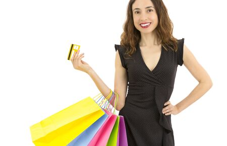 Shopping woman with her credit card photo