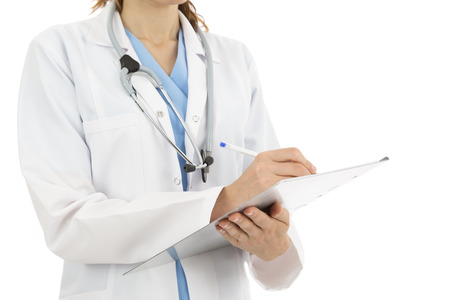Female doctor keeping notes on a clipboard photo