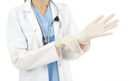 quirurgico: M�dico usando guantes quir�rgicos Foto de archivo