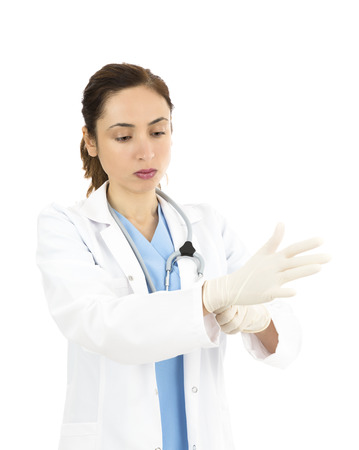 Female doctor wearing surgical gloves
