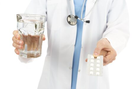 doctor giving glass: Doctor giving medicine with a glass of water