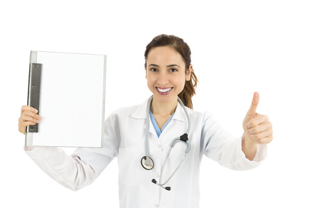 Friendly female doctor with a clipboard giving thumbs up photo