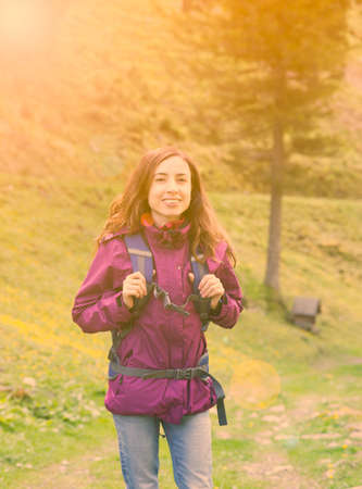 Woman hiking in nature on Swiss alps in spring