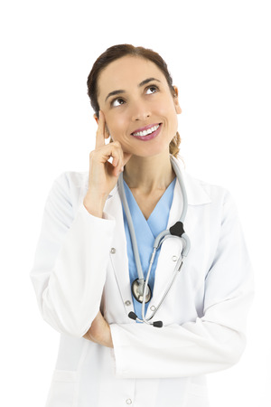 Female doctor looking up to copy space Stock Photo