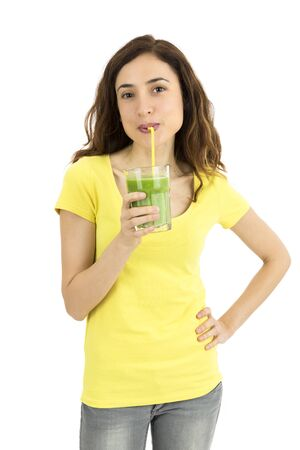 Healthy lifestyle woman drinking green smoothie