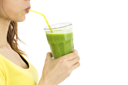 Profile view of woman drinking green smothie Stock Photo
