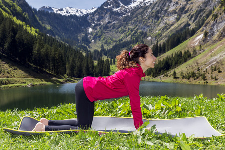 Woman doing cow pose outdoors
