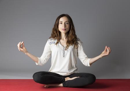 sukhasana: Meditating yoga woman