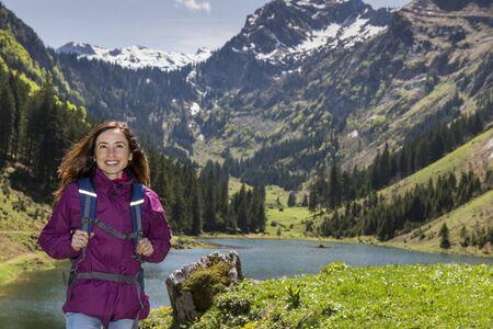 Woman hiking by lake