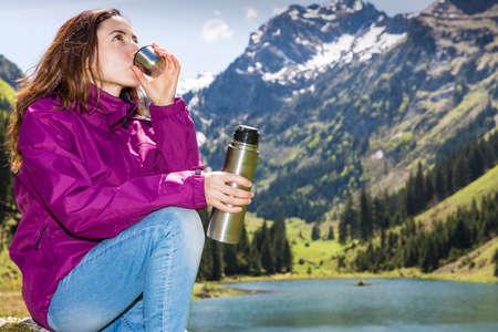 Woman drinking water during hiking