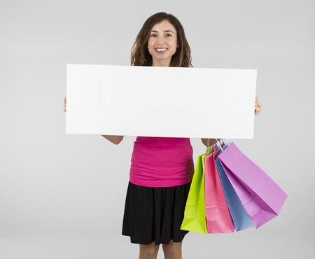 displaying: Shopping woman displaying banner