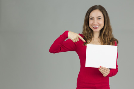 copy  space: Woman pointing to copy space