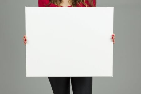 exhibiting: Woman showing banner