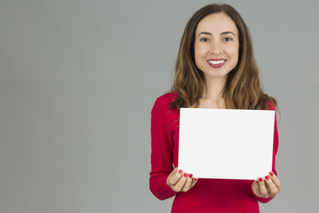 advertisement: Woman holding an advertisement placard Stock Photo