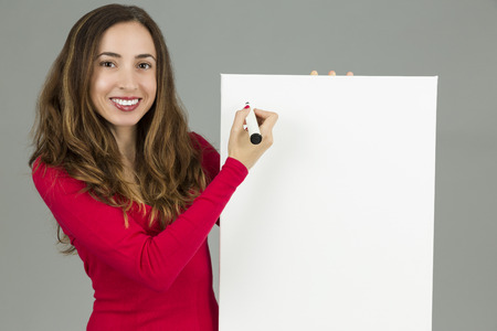 board marker: Woman writing on a marketing board with a marker