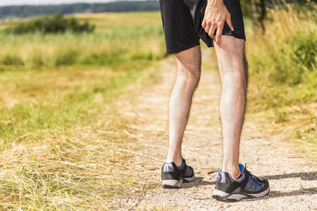 muscle aches: Jogger having muscle pain Stock Photo