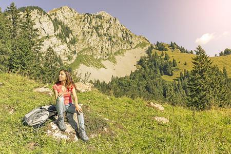 taking a break: Woman hiker taking a break