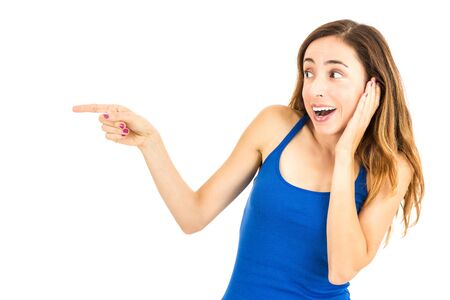 Woman excitedly pointing to copy space Stock Photo