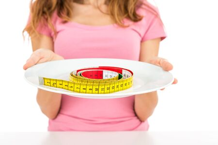 measurement tape: Measurement tape on a plate Stock Photo