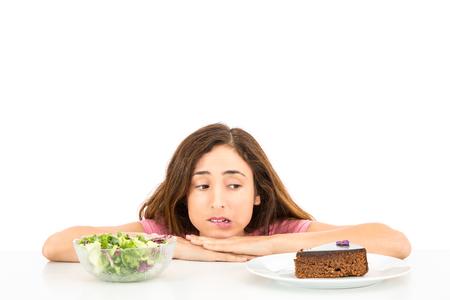 deciding: Diet woman deciding between cake and salad Stock Photo