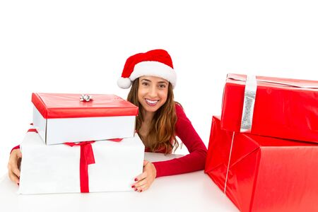 woman behind: Happy christmas woman behind her present boxes