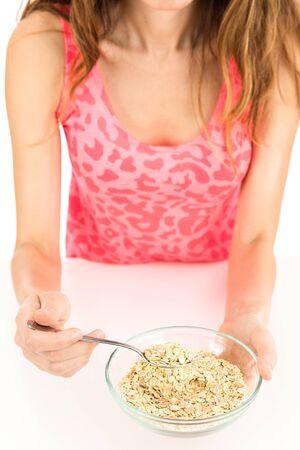 oatmeal bowl: Female hands holding an oatmeal bowl