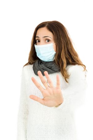 woman stop: Flu woman with a virus mask giving stop sign Stock Photo