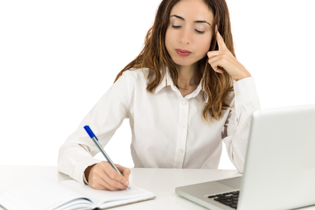 concentrated: Business woman concentrated at work Stock Photo