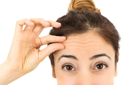 aging face: Wrinkles on female forehead Stock Photo