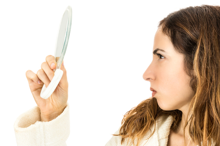 woman mirror: Woman looking to mirror
