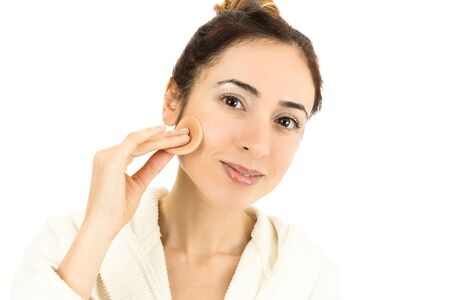 beautycare: Woman with her make up sponge Stock Photo
