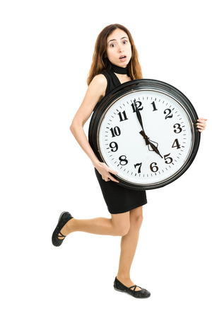 hurried: Woman in a hurry running with a big clock