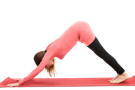 Woman doing Downdog pose Standard-Bild