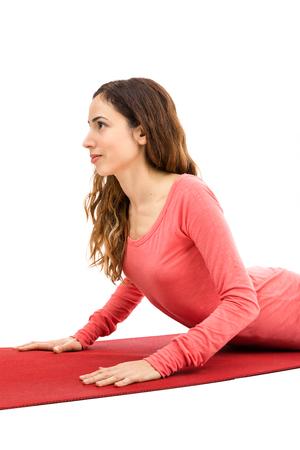 bhujangasana: Attractive woman doing cobra pose in yoga Stock Photo