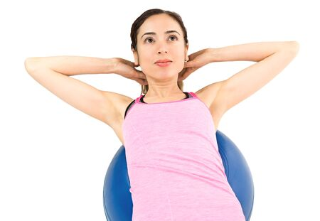 Woman training her abs on pilates ball Stock Photo