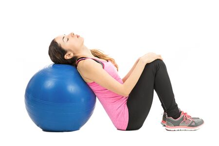 pilates ball: Woman relaxing on pilates ball Stock Photo