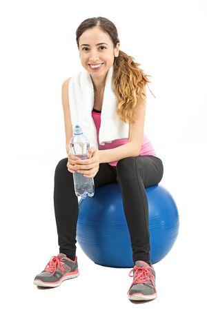 pilates ball: Fitness woman sitting on a pilates ball Stock Photo