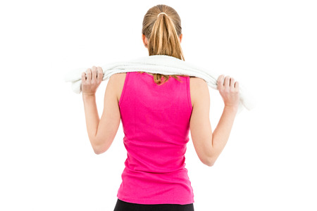 Back of a woman with a towel around her shoulder after work out Stock Photo