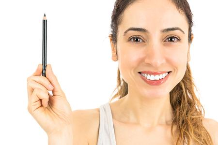 Woman showing eyebrow pencil Standard-Bild