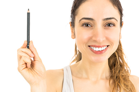 Woman showing eyebrow pencil Stock Photo