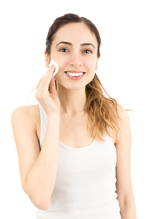 cotton ball: Woman cleaning her make up with a cotton ball