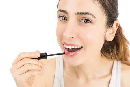 lip stick: Attractive woman using lip stick