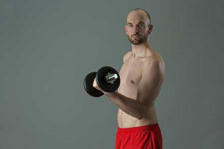 strengthening: Man training with weights Stock Photo