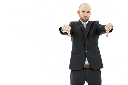 unsuccessful: Caucasian business man giving thumbs down. Isolated on white background. Stock Photo
