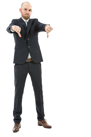 disapprove: Business man shows his dislike by showing thumbs down. Isolated on white background.