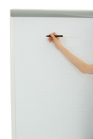 person writing: Arm of a business person writing on a board with a marker. Isolated on wite background.