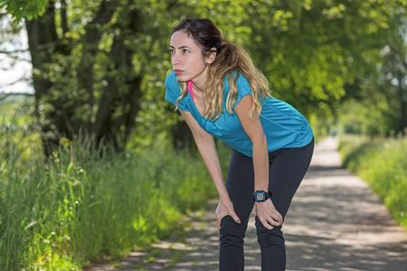 taking a break: Sportswoman outdoors taking a break. Stock Photo