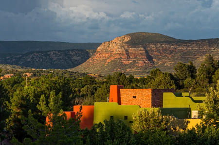Sedona Mountains and Colorful Buildings at Sunset