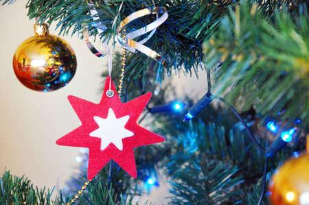 Christmas lights and baubles on the christmas tree photo